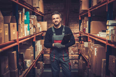 Storekeeper with manual pick list on a warehouse Stock Photo