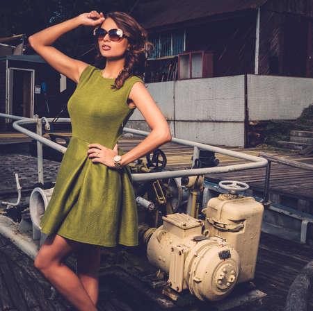 Stylish woman on old rusty boat