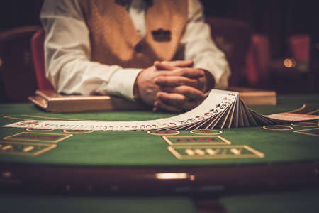 Croupier behind gambling table in a casino