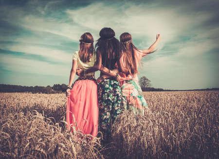 Multi-ethnic hippie girls in a wheat field 版權商用圖片