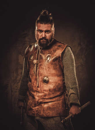 Viking with axes in a traditional warrior clothes Stock Photo