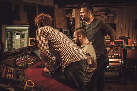 Guys working in boutique recording studio