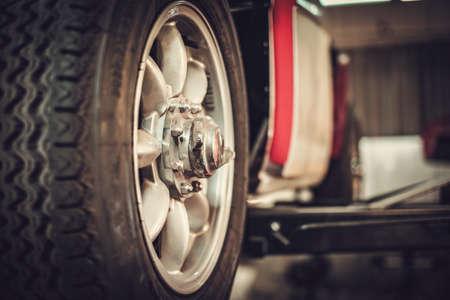 Wheel of classic car in a workshop