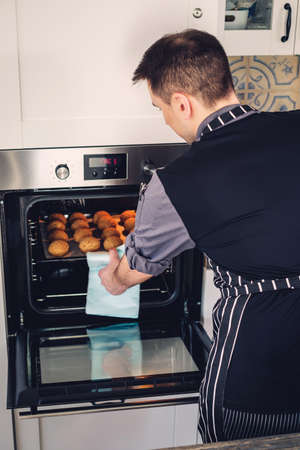 Chef cook working on a modern kitchen at home Stock Photo