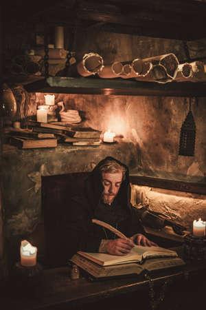 Monk chronicler writes an ancient manuscript Reklamní fotografie - 78788990