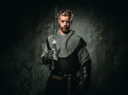 Medieval knight with sword and armour