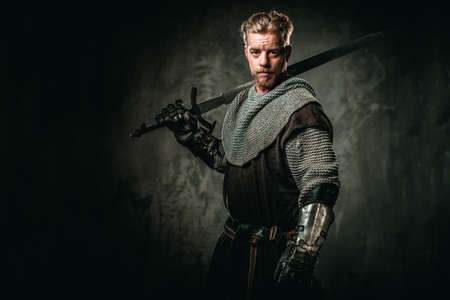Medieval knight with sword and armour Stock Photo - 79865407