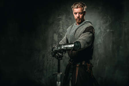 Medieval knight with sword and armour Stock Photo - 79865418