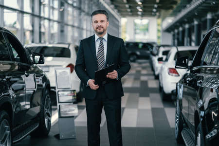 Top sales manager at dealership showroom