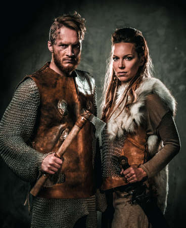 Vikings couple posing in studio.