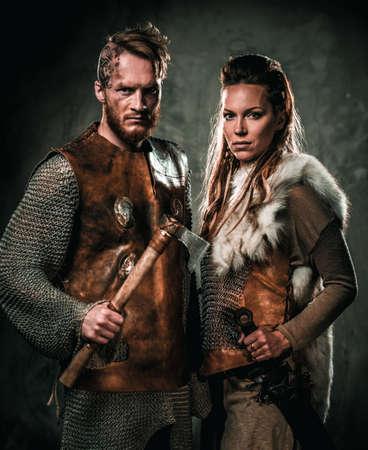 Vikings couple posing in studio.