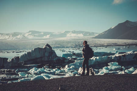 Woman explorer lookig at Jokulsarlon lagoon, Iceland. Stock fotó