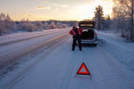 Broken on a snowy winter road.