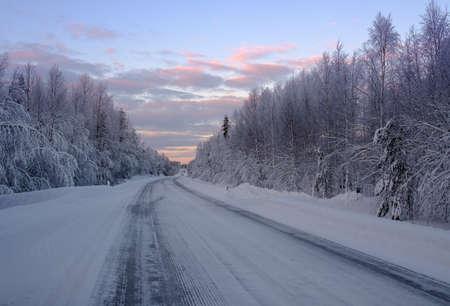 Beautiful snowy road in winter landscape.