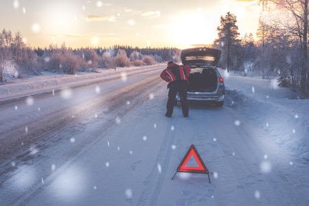 Broken car on a snowy winter road.