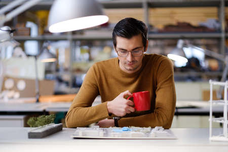 Man working in design and engineering architecture office.
