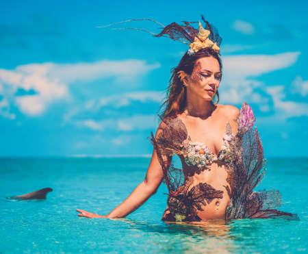 Portrait of exotic fantasy mermaid in blue ocean. Archivio Fotografico