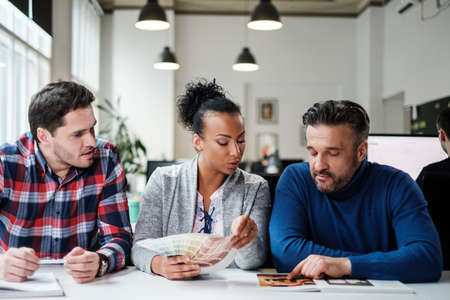 Multi-ethnic colleagues in a coworking office. Stock Photo