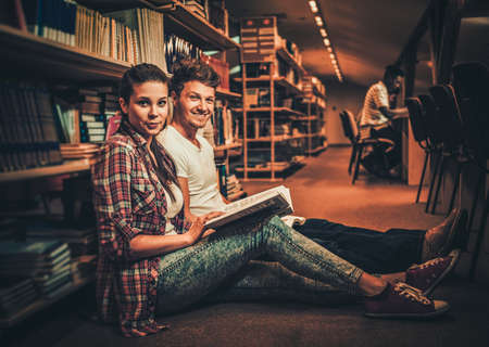 Couple of students studying in the university library.