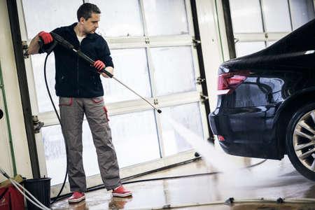 Man working on a car wash.