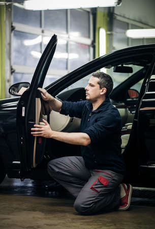 Man polishing car on a car wash. Stock Photo