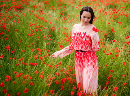 Beautiful young in the poppy field