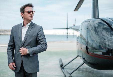Businessman near private helicopter Stock Photo - 103588178