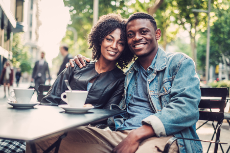 Young happy black couple outdoors