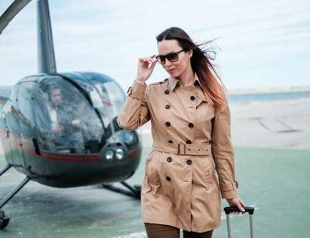 Business woman near private helicopter Stock Photo - 103911714