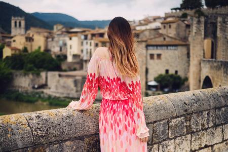 Beautiful young woman in Besalu, Spain Stock Photo