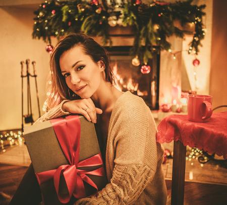 Beautiful youn woman with a Christmas gift Standard-Bild - 107922519