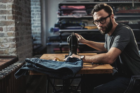 Fashion designer working in his studio Stockfoto