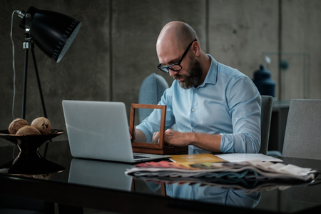 Middle-aged designer working in office