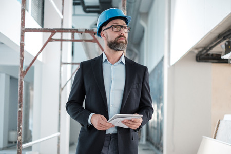 Middle-aged engineer in hardhat