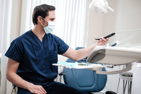 Man dentist working in private practice.