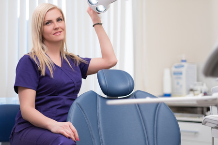 Young beautiful blond woman dentist at dentists surgery Archivio Fotografico
