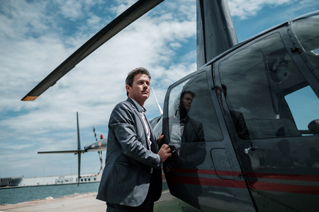 Businessman entering his private helicopter Фото со стока