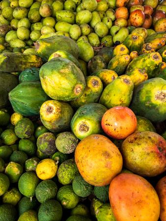 Colourful papaya furits on a market.