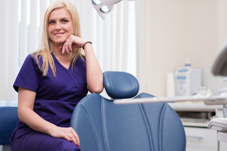 Young beautiful blond woman dentist at dentists surgery Stock Photo
