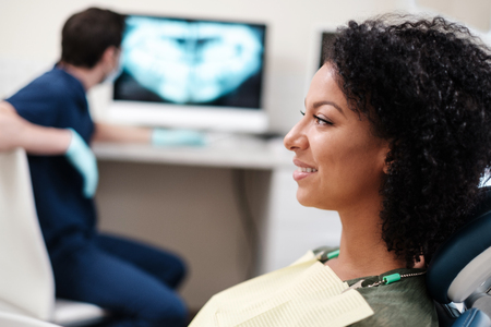Woman patient at dentists private practice. Stock Photo