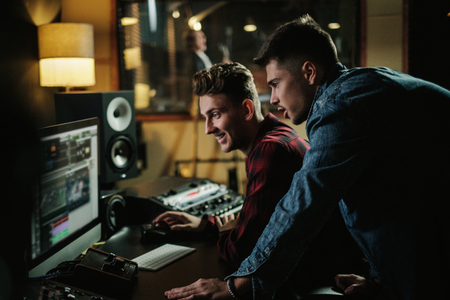 Sound engineer working in a music studio Stock Photo - 119736726