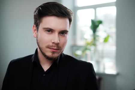 Confident young man attending job interview Stock Photo