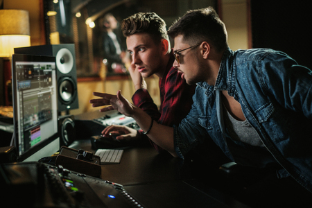 Sound engineer working in a music studio Stock Photo - 121899436