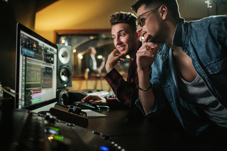 Sound engineer working in a music studio Stock Photo