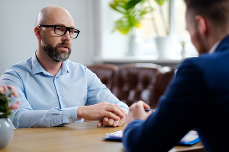 Middle-aged man attending job interview