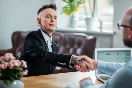 Alternative man attending job interview