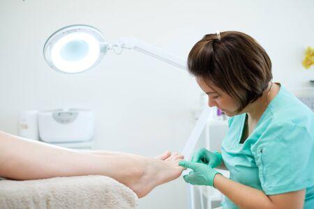 Woman having pedicure at beauty salon