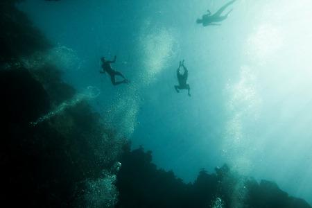 Underwater view of snorkelers in a water