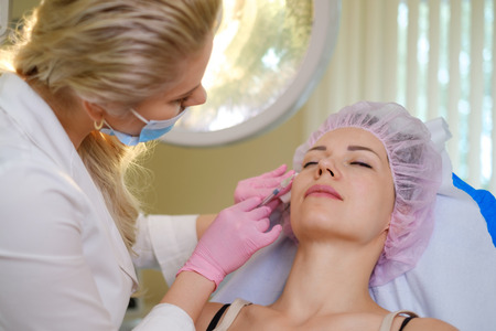 Woman getting treatment with injectable hyaluronic acid dermal filler
