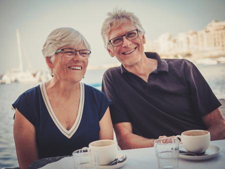 Retired couple enjoying coffee on a resort